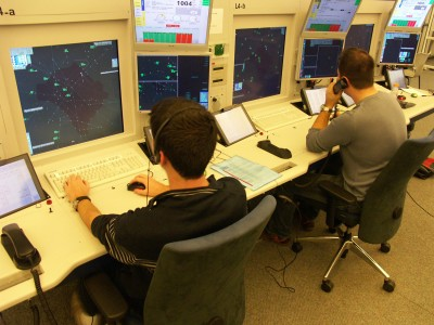Air traffic controllers at their stripless workstations, UAC West, Geneva