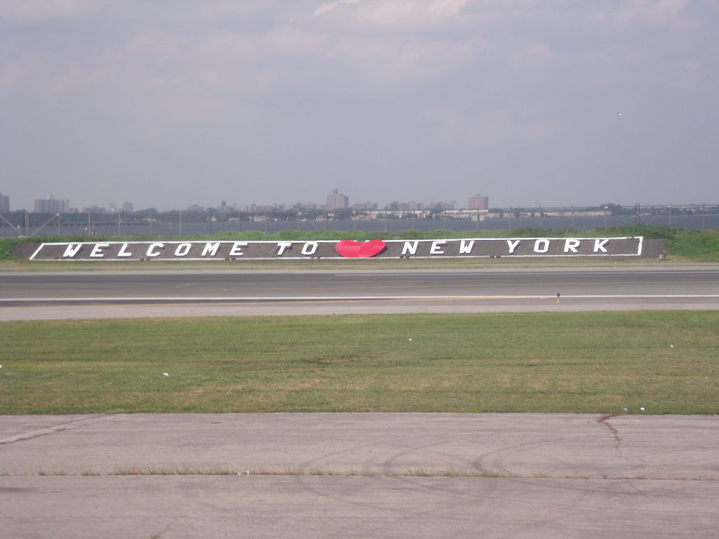 """Welcome to New York"" sign at LaGuardia airport"