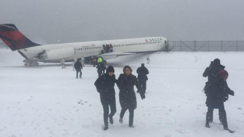 Delta plane skids off LaGuardia runway